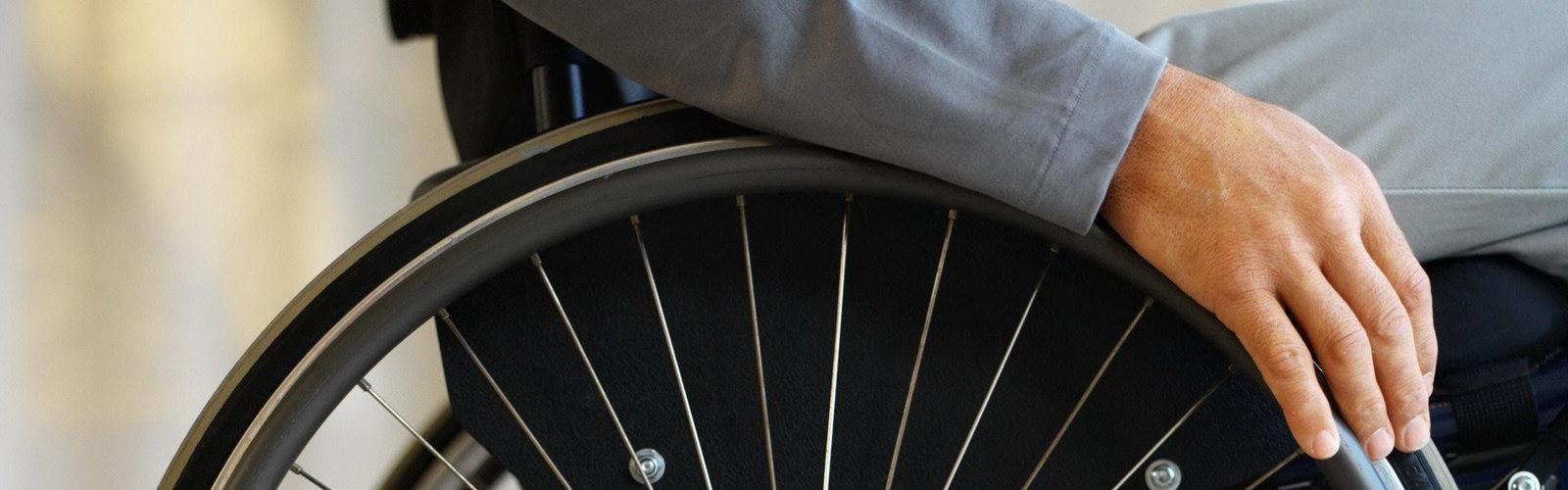 Man utilising his wheelchair